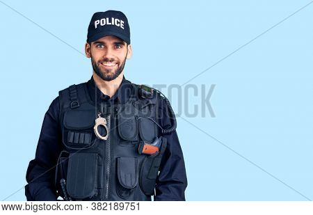 Young handsome man with beard wearing police uniform with a happy and cool smile on face. lucky person.