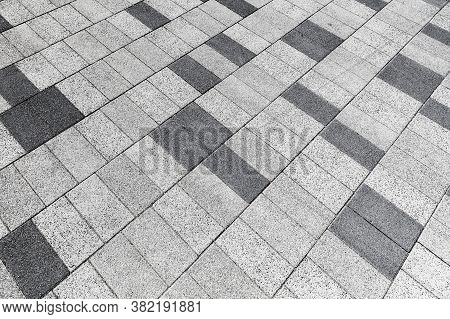 Cobbled Road Structure, Random Pattern Of A Stone Street Pavement, Abstract Background Photo Texture