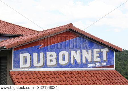 L'arbresle, France - June 27, 2020: Old Advertising Of Dubonnet Beverage On A House In France. Dubon