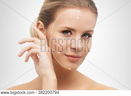 Close-up portrait of young, beautiful and healthy woman ready for plastic surgery treatment.