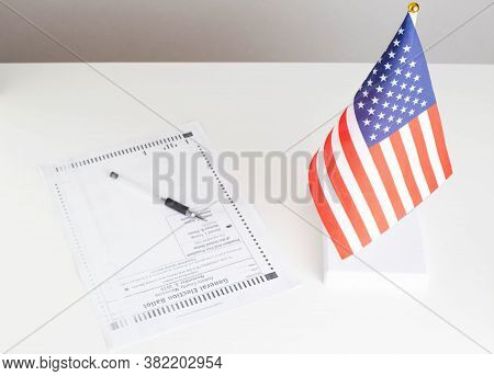 Empty Paper Ballot Is On Table In Presidential Election Of United States 2020. Flag Of The Usa. Choi