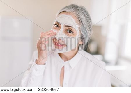 Promo Of Anti-aging Facial Masks Concept. Copy Space. Headshot Of Attractive Caucasian Elderly Woman