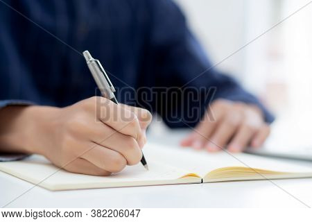 Closeup Hand Of Man Writing On Notebook With Pen On Desk, Freelance Is Author, Businessman Write On