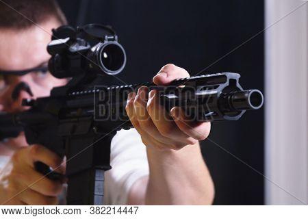Ozarow Mazowiecki, Poland 10.20.2019 Man Shooting With Rifle With Collimator On A Shooting Range.