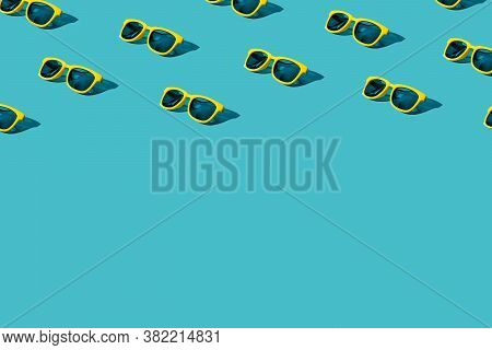 Yellow Sunglasses Pattern With Turquoise Blue Background. Trendy Minimalist Sunglasses Background. S