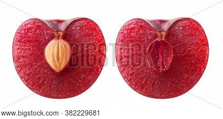 Isolated Cherry Halves. Fresh Sweet Cherry Fruit Cut In Half With And Without Kernel Isolated On Whi