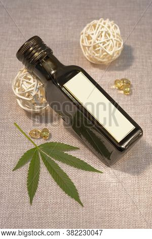 Bottle Of Hemp Oil With Cannabis Leaf With Capsules