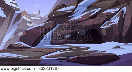 Entrance To Cave In Mountain With Ice And Snow On Rocks Around. Grotto, Hidden Underground Tunnel Or