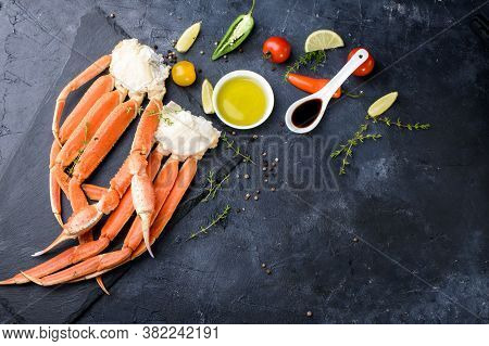 Fresh Crab Claws, Lime, , Ice, Shrimp, Vegetables On A Dark Background.