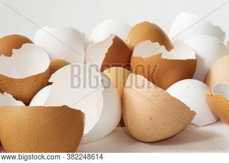 Close-up Of Broken Empty Eggshells On White Background.