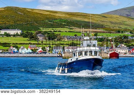 Boat Tour Leaving Dingle Harbour For Sightseeing And Fungie Dolphin Watching With Dingle Village In