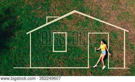 girl enters the house drawn on a lawn