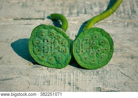 Closeup Of Nelumbo Nucifera Pods Or Indian Lotus Pods On Wooden Surface