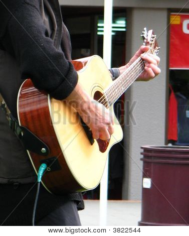 Playing A Guitar