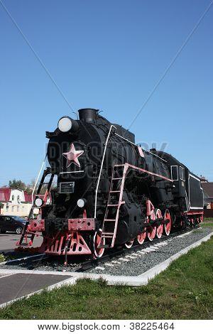 Russia, Chuvash Republic, Shumerlya. Monument locomotive engine L-579. poster