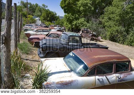 Junk Yard With Old Beautiful Oldtimers On The Route 89