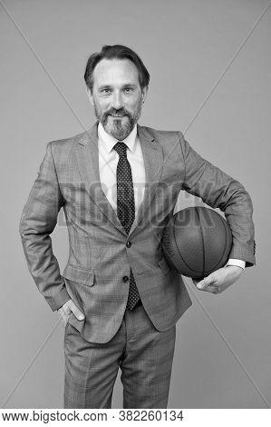 Ambitious Coach. Business Coach Hold Basketball Ball. Basketball Coach Grey Background. Confident Co