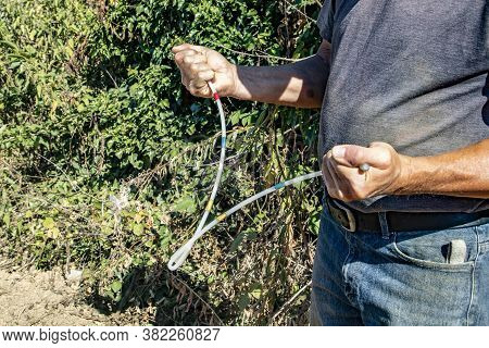 Man With His Divining Rod In Hands Searching For Water