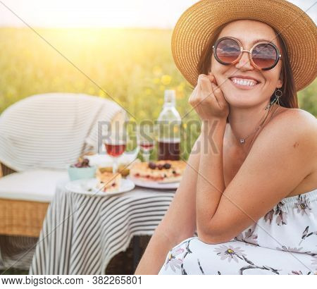 Smiling At Camera Young Sincerely  Woman In Sunglasses And Straw Hat Dressed Light Summer Dress Sitt