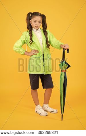Dry And Comfortable In Rainy Weather. Small Girl In Raincoat With Umbrella. Schoolgirl Waterproof Ra