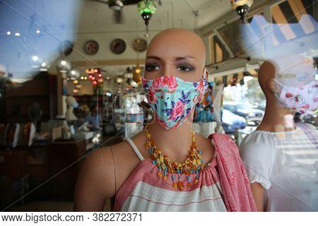 Laguna Beach, California / USA - August 23, 2020: A store mannequin wears a Covid-19 Face Mask for sale in Laguna Beach California. Editorial Use Only.