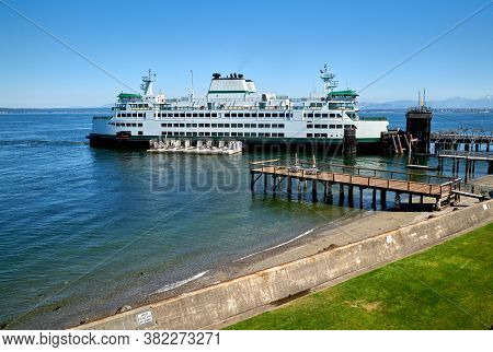 Mukilteo Ferry Dock. A Washington State Ferry At The Mukilteo Ferry Dock On Puget Sound. Washington