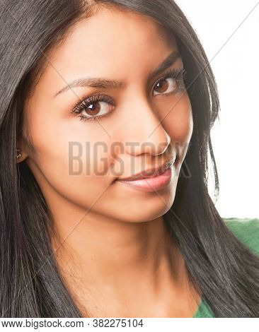 Attractive smiling young woman with Latina ethnicity.