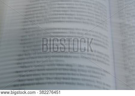 Closeup Of Book Page Intentionally Blurred For Effect.
