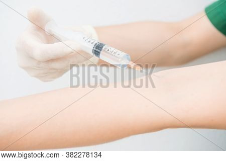 Cropped Shot View Of Someone Injecting Themself With A Syringe Into A Vein On The Arm. Syringes Are