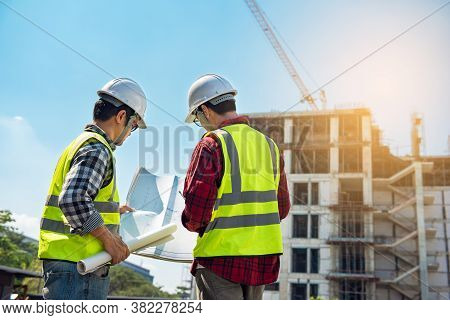 Civil Engineer Project Construction Work. Engineer Foreman Wearing Helmet Discussion Work Control To