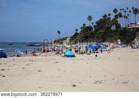 Laguna Beach, California / USA - August 23, 2020: People enjoy the beach in Laguna Beach California during the Coronavirus Pandemic. Editorial Use Only