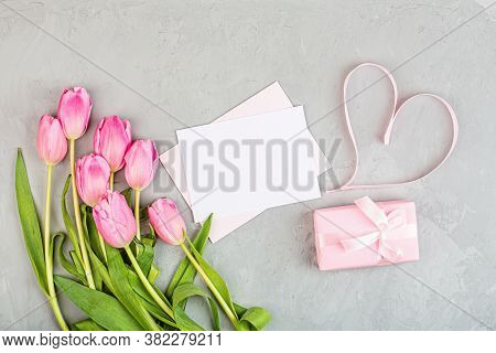 View From Above Tulips And Gift Box With Copy Space On Gray Concrete Background. Womens Day, 8 March