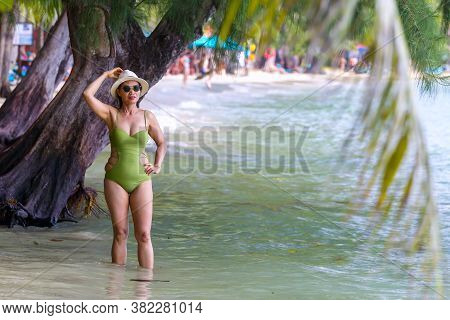 Woman Traveler Pretty With Swimsuit At Beach Koh Chang Thailand. Koh Chang Is Located In The Eastern