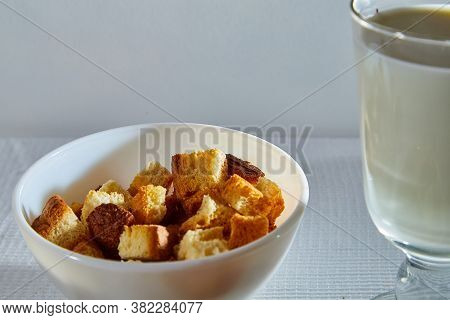 Square Toasted Pieces Of Homemade Delicious Rusk, Hardtack, Dryasdust, Zwieback And Glass Of Milk On