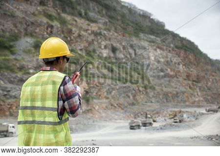 Woman Engineer And Safety Officer Concept.young Woman Engineer Talking Portable Radio, And Wear Safe
