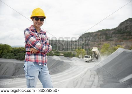 Woman Engineer And Safety Officer Concept.young Woman Engineer Wearing Safety Hat (helmet), Safety G