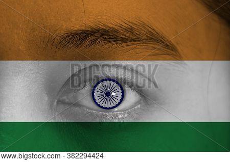 Human Face Painted With Indian Flag And Ashoka Chakra Wheel On The Center Of Eye Or Eyeball. Human E