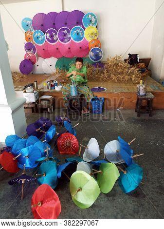 Bor Sang, Chiang Mai, Thailand, December 22, 2018: A Craftswoman Works On Making Umbrellas At The Bo