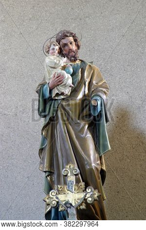 PRELOSCICA, CROATIA - JULY 22, 2011: Saint Joseph holds baby Jesus, statue on the altar in Saint Michael the Archangel Parish Church in Preloscica, Croatia