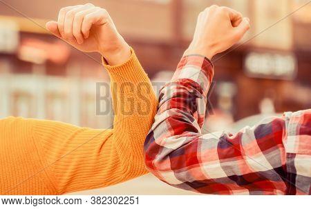Elbow Bump. Bump Elbows. Friends Shaking Elbows Outdoors. Elbow Greeting Style. Coronavirus Epidemic