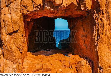 Hole In The Rocks In Rocce Rosse Beach In Sardinia, Italy