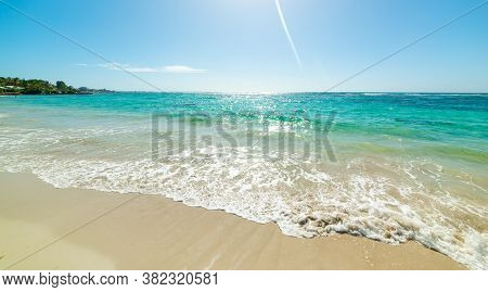 Turquoise Sea And Shining Sun In Guadeloupe, French West Indies. Lesser Antilles, Caribbean Sea
