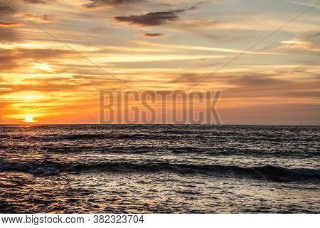 Cloudy Sky Over Porto Ferro At Sunset. Sardinia, Italy