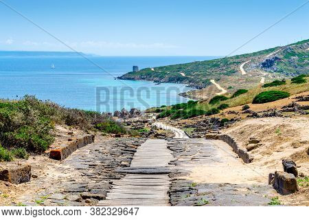 Downhill Path In Tharros Archaeological Site On A Sunny Day. Sardinia, Italy