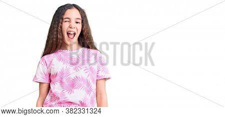 Young girl blinking eye over white isolated background