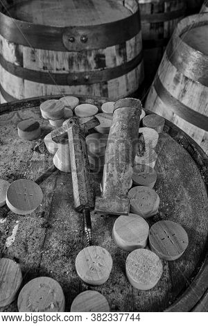Tools To Insert And Remove Bungs From Whisky Barrels, On The Top  Of A Dusty Old Whisky Barrel, Blac