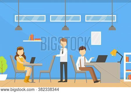 Coworking Space With People Sitting At Desks With Laptop Computers, Team Working Together In Coworki