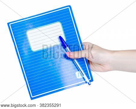 School Exercise Book With Pen In Hand On White Background Isolation