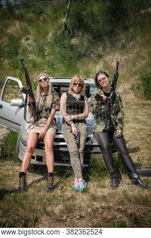 Military Team Of Three Attractive Female Soldier. Woman With Weapon