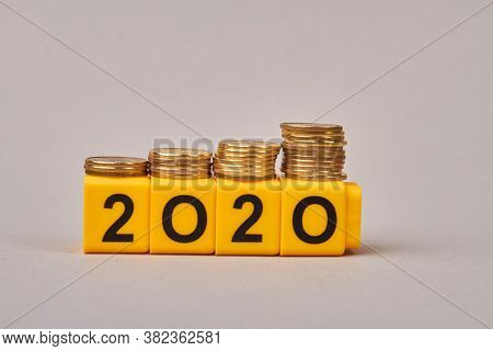 Budget Planning For 2020. Wooden Blocks With Number 2020 Isolated On Grey Background. Concept Of Sav